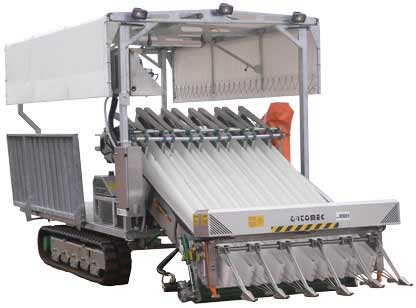 Ortomec 9000 harvester with folded canopy and deck
