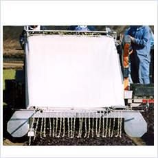 Harvester wind screen